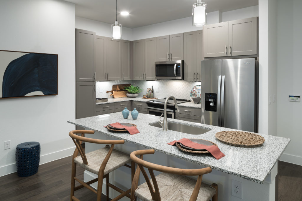 gourmet kitchen with stainless steel appliances at Alexan Garza Ranch - Dive Into Pure Bliss and Style