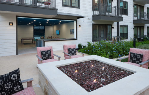 fire pit in the courtyard w/ seating at Alexan Garza Ranch - Picture an Ideal Weekend